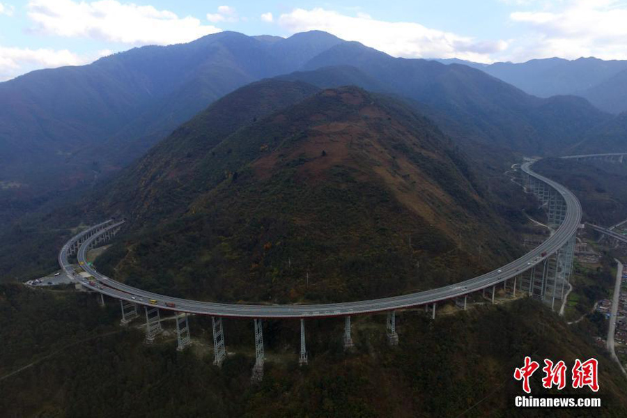 "World's longest concrete tubular bridge described as ""roller coaster"""