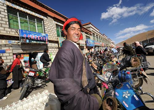 Tibetan farmers and herders' income grows by 12 pct