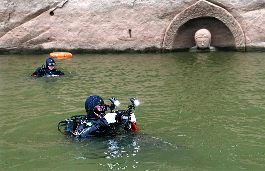 Ancient Buddha found as water level of reservoir lowers in E China