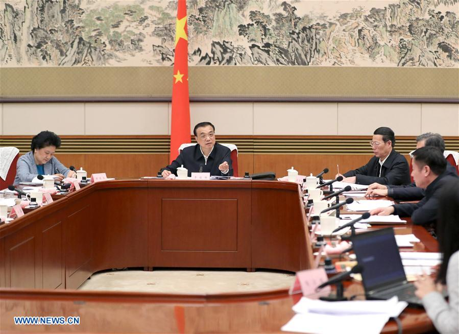 Chinese premier hears opinions on gov't work report