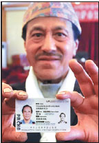 Foreigners in Tibet 'really happy' to be given green cards