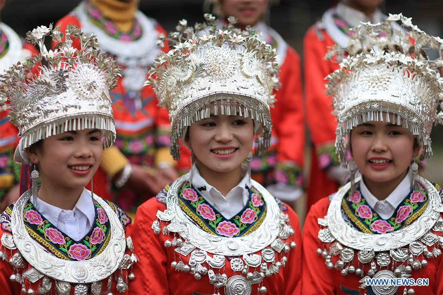 People of Miao ethnic group take part in folk events welcoming spring