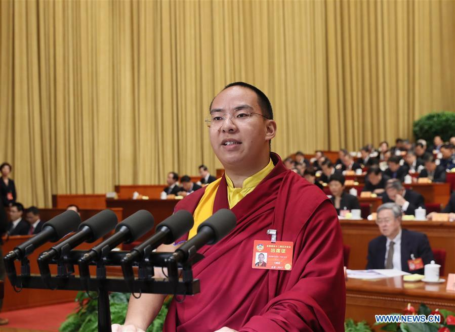 Panchen Lama laments Buddhism threatened by commercialization