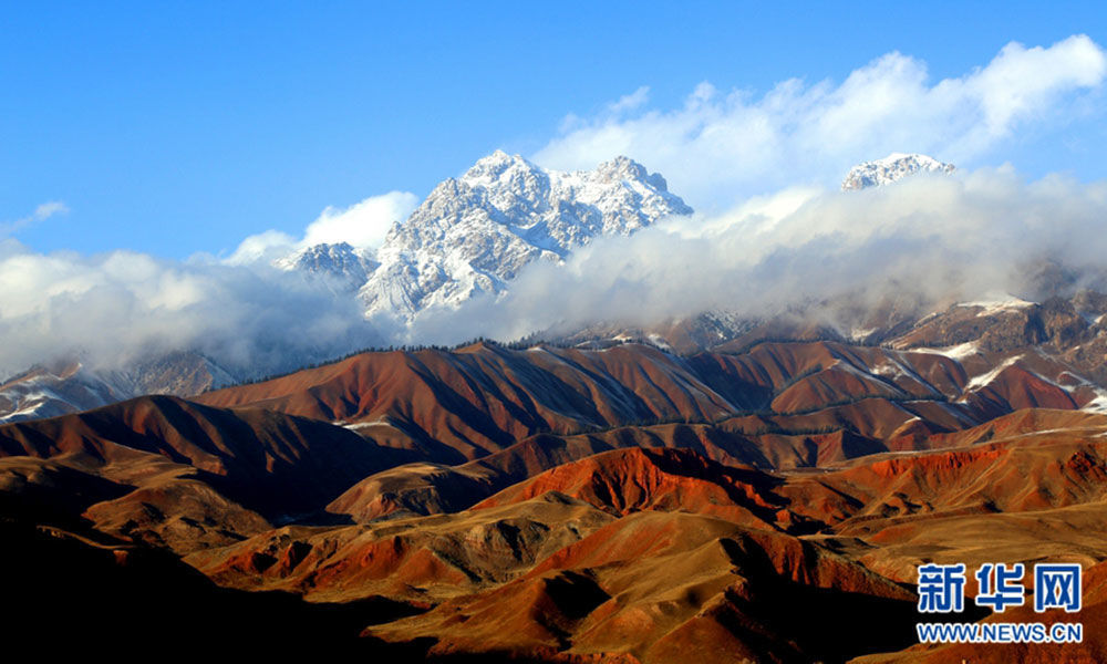 Spring snow adds charm to Qilian Mountain