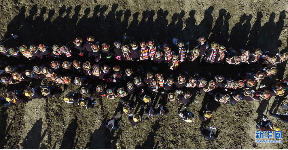 Overlooking view of Spring ploughing ceremony in Tibet