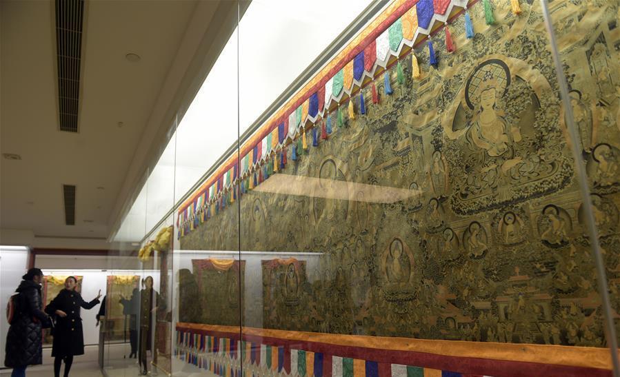 "People view Tibetan art of scroll painting ""Thangka"" in Beijing"