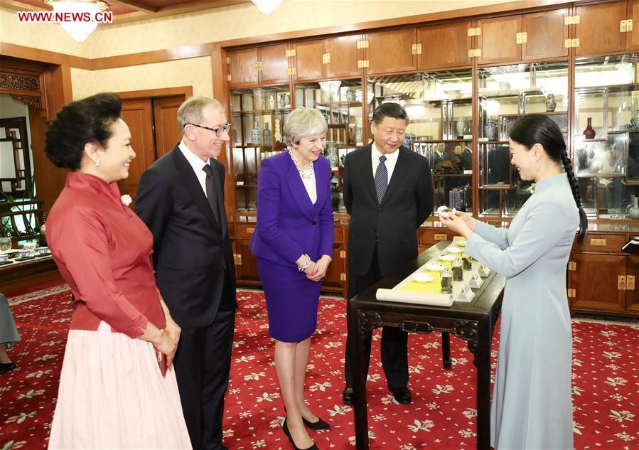 Mays China-Besuch zerstreut Besorgnis über Protektionismus