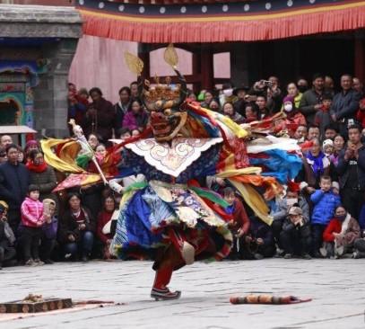 Cham dance lights up Butter Lamp Festival for Tibetans