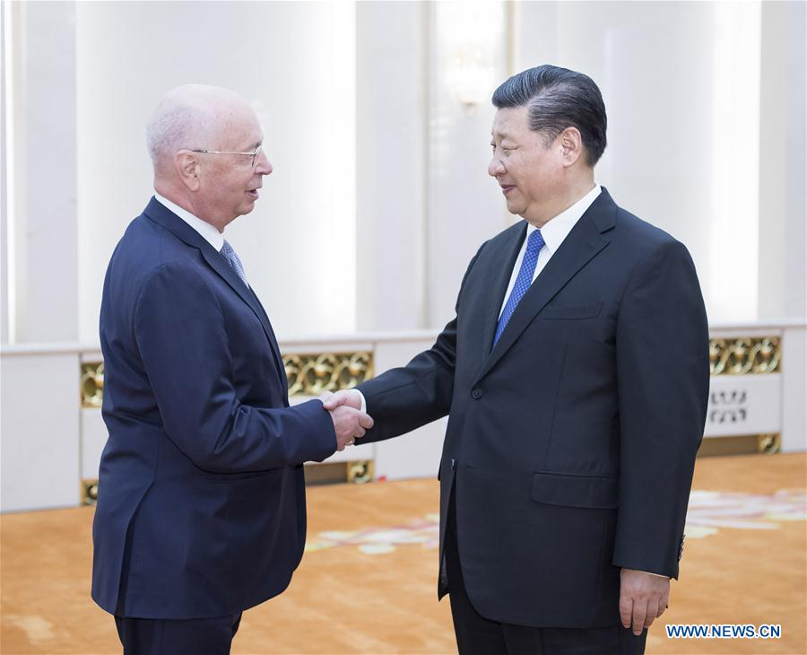 Xi meets Schwab, vows greater opening up
