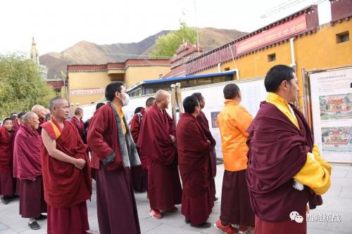 比如县举办藏传佛教活佛转世专题展览活动