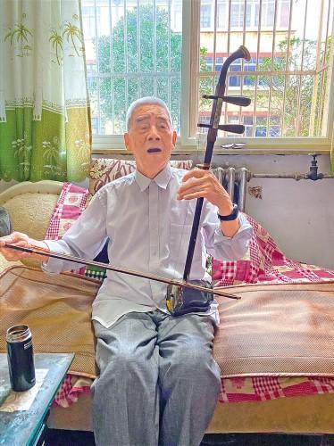 拉起二胡,再为西藏唱首歌