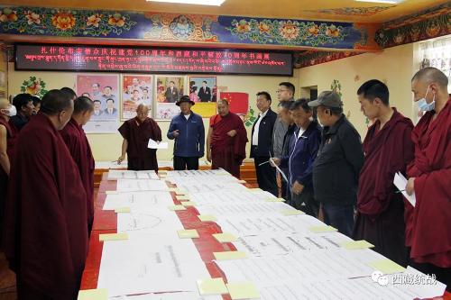 扎什伦布寺管委会组织僧众广泛开展庆祝建党100周年暨西藏和平解放70周年书画展活动